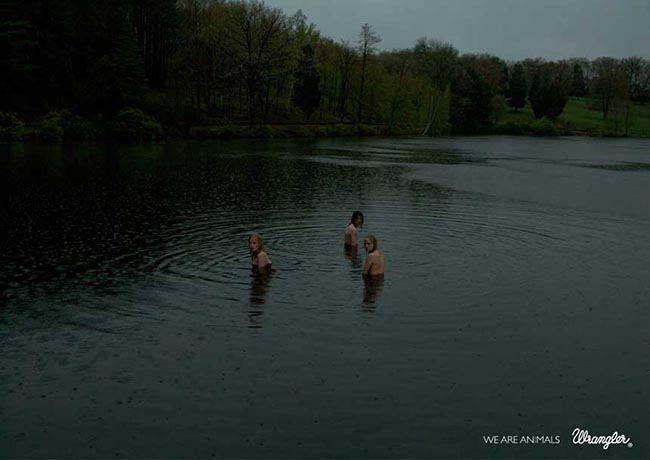 Three swimmers in Wranglers We Are Animals print advertisement